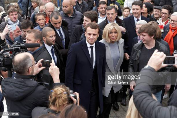 French presidential candidate Emmanuel Macron for the En Marche movement flanked by his wife Brigitte Trogneux surrounded by supporters leave the...