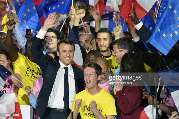 French Presidential Candidate Emmanuel Macron salutes voters after a political meeting at Grande Halle de La Villette on May 1 2017 in Paris France...