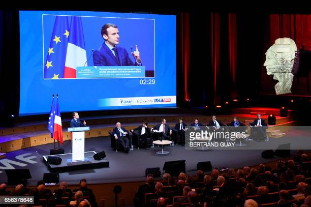 TOPSHOT French presidential candidate for the 'En Marche' movement Emmanuel Macron delivers a speech during an exceptional gathering of mayors of...