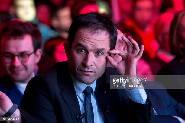 French presidential candidate for the left-wing French Socialist Party Benoit Hamon looks on during a campaign meeting on February 23, 2017 in Arras,...