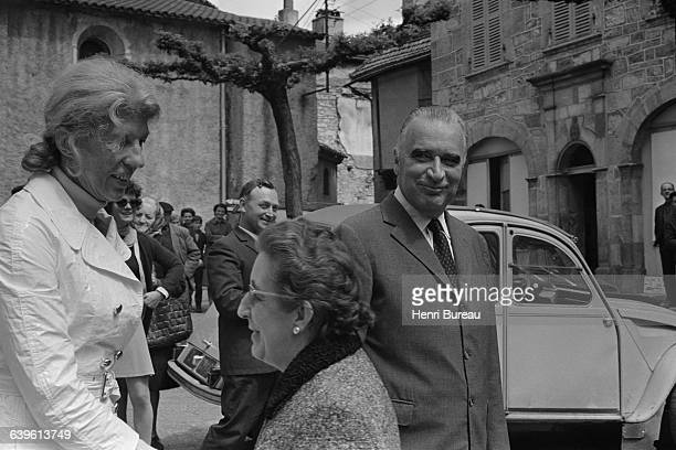 French Presidential candidate Georges Pompidou and his wife Claude are greeted by townspeople in Cajarc