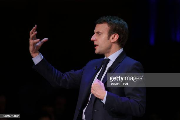 TOPSHOT French presidential election candidate for the En Marche movement Emmanuel Macron speaks on stage at a campaign event in central London on...