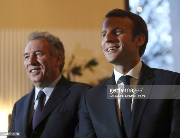 TOPSHOT French presidential election candidate for the En Marche movement Emmanuel Macron and center right party MoDem president Francois Bayrou pose...