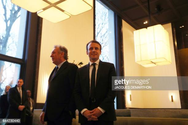 TOPSHOT French presidential election candidate for the En Marche movement Emmanuel Macron and center right party MoDem president Francois Bayrou...