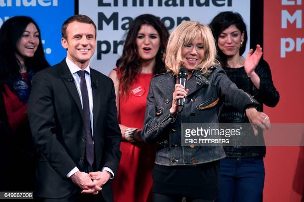 French presidential election candidate for the En Marche movement Emmanuel Macron and his wife Brigitte Trogneux attend an event organised by the...