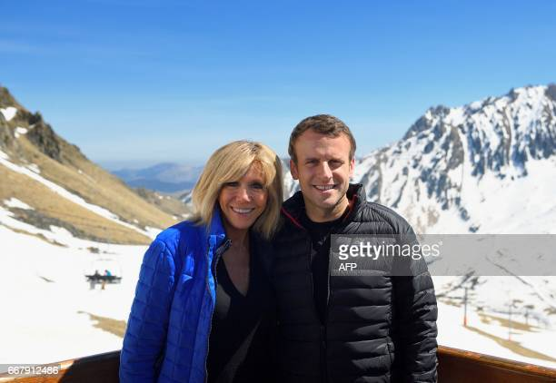 French presidential election candidate for the En Marche movement Emmanuel Macron and his wife Brigitte Trogneux pose during a campaign visit in...