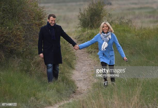 French presidential election candidate for the En Marche movement Emmanuel Macron and his wife Brigitte Trogneux pose for the photograph on April 22...