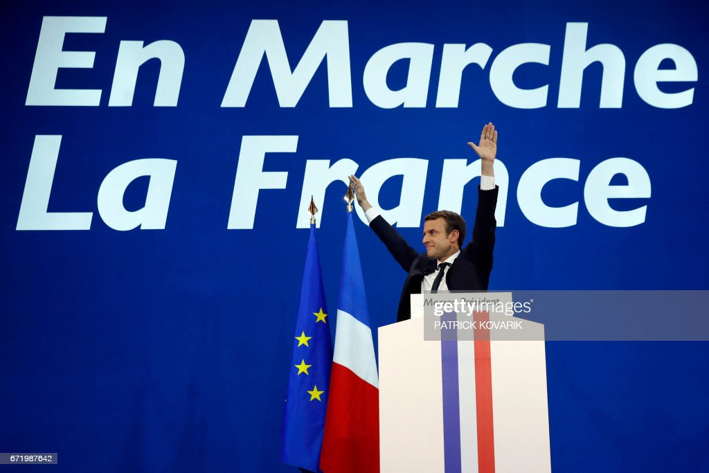 French presidential election candidate for the En Marche ! movement Emmanuel Macron delivers a speech at the Parc des Expositions in Paris, on April 23, 2017, after the first round of the Presidential election. / AFP PHOTO / Patrick KOVARIK