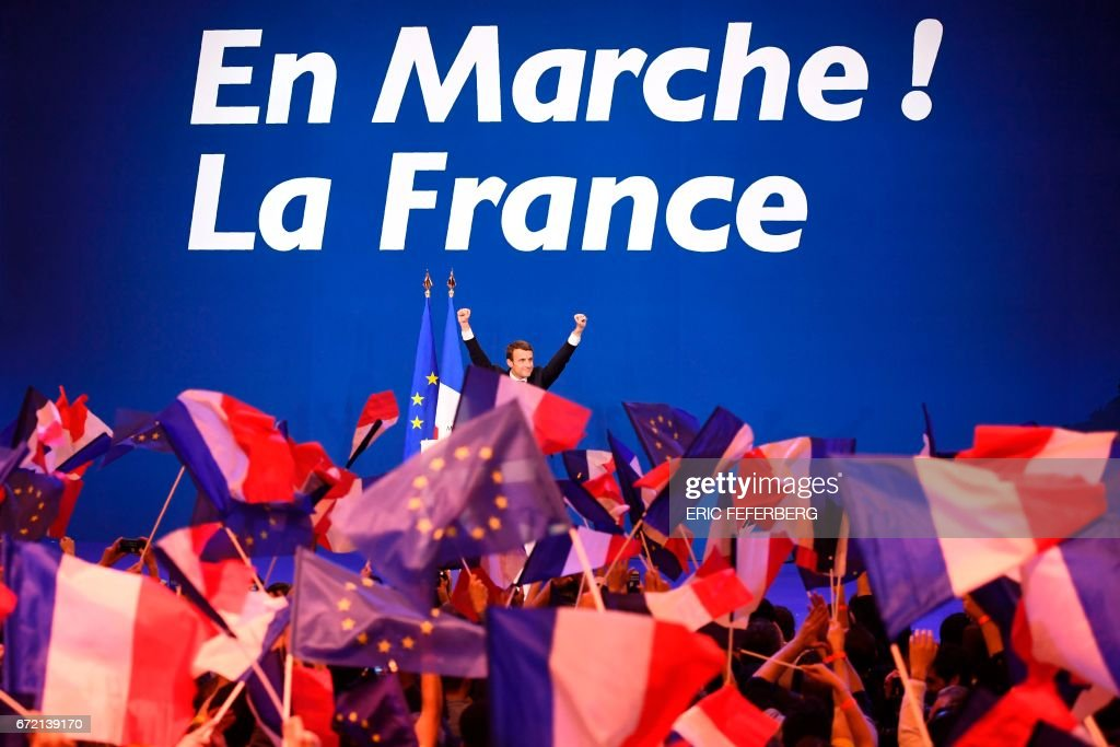 French presidential election candidate for the En Marche ! movement, Emmanuel Macron celebrates on stage at the Parc des Expositions in Paris, on April 23, 2017, after the first round of the Presidential election. Pro-European Emmanuel Macron is set to face far-right candidate Marine Le Pen in France's presidential run-off, results showed on April 24, making him clear favourite to emerge as the country's youngest leader in its history. / AFP PHOTO / Eric FEFERBERG