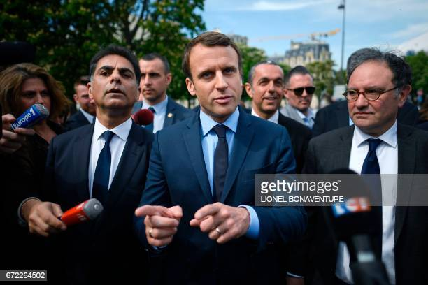 French presidential election candidate for the En Marche movement Emmanuel Macron next to Mourad Franck Papazian copresident of France's Armenian...