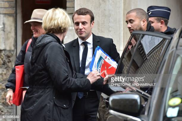 French presidential election candidate for the En Marche ! movement, Emmanuel Macron leaves his Paris home on April 25, 2017 to go to his campaign...