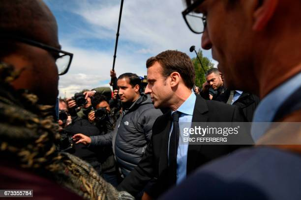 French presidential election candidate for the En Marche movement Emmanuel Macron arrives to visit the Whirlpool factory in Amiens northern France on...