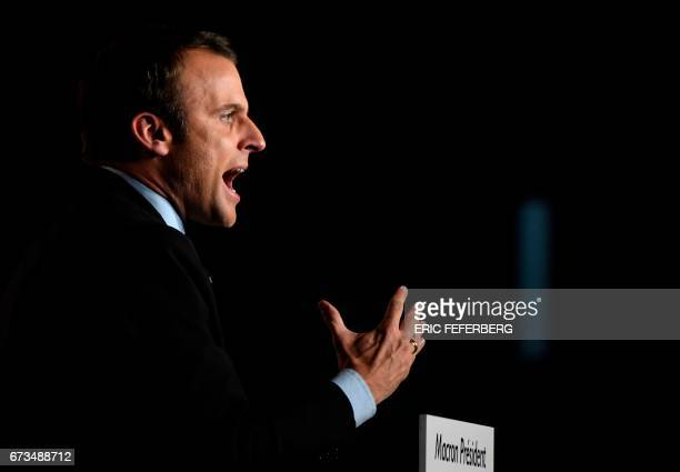 French presidential election candidate for the En Marche ! movement Emmanuel Macron gestures as he gives a speech during a meeting in Arras, on April...