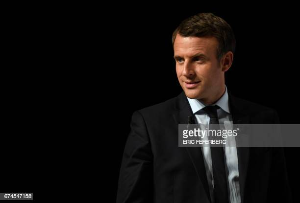 TOPSHOT French presidential election candidate for the En Marche movement Emmanuel Macron addresses supporters at the Angerlarde hall in...