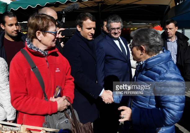 French presidential election candidate for the En Marche movement Emmanuel Macron flanked by Alain Claeys mayor of Poitiers and by his bodyguard...