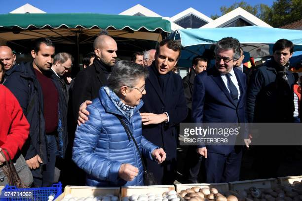 French presidential election candidate for the En Marche movement Emmanuel Macron flanked by Alain Claeys mayor of Poitiers and top security French...