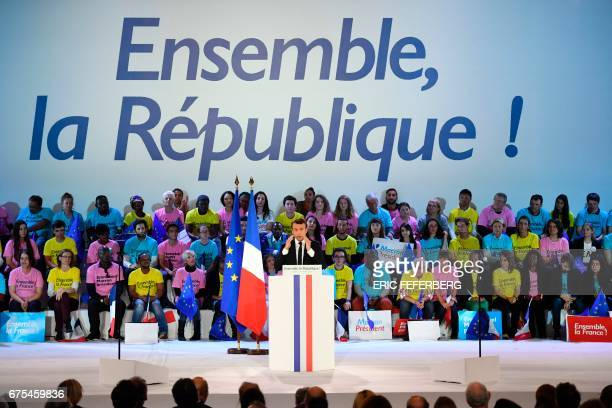 French presidential election candidate for the En Marche movement Emmanuel Macron delivers a speech on stage during a campaign rally on May 1 2017 at...