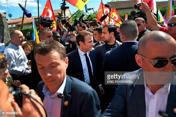 French presidential election candidate for the En Marche movement Emmanuel Macron escorted by bodyguards including his bodyguard Alexandre Benalla is...