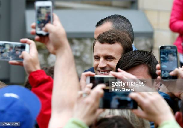 French presidential election candidate for the 'En Marche!' political movement, Emmanuel Macron leaves his house prior his vote at the polling...