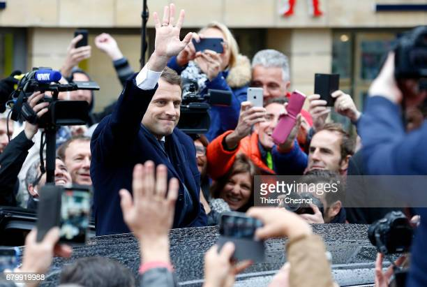 French presidential election candidate for the 'En Marche' political movement Emmanuel Macron leaves his house prior his vote at the polling station...
