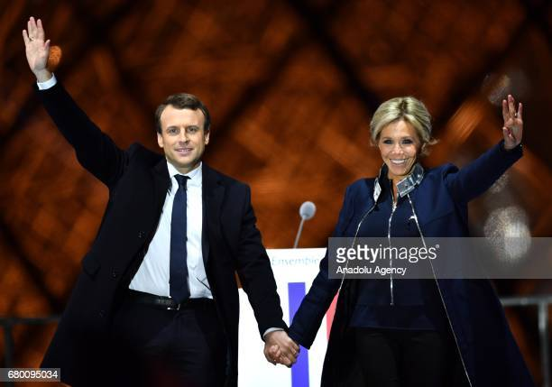 French presidential election candidate for the 'En Marche' political movement Emmanuel Macron greets with his wife Brigitte Trogneux after winning...