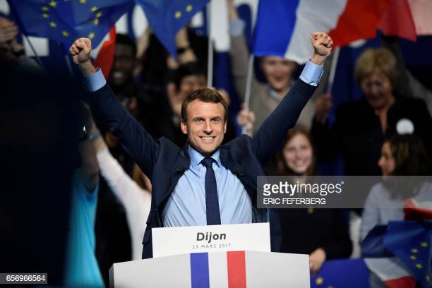 French presidential election candidate for the En-Marche movement Emmanuel Macron gestures as he delivers a speech during a campaign rally in Dijon...