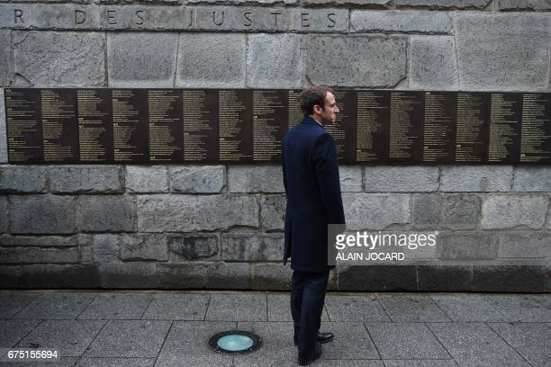 TOPSHOT French presidential election candidate for the EnMarche movement Emmanuel Macron stands by the Wall of the Righteous during a visit to the...
