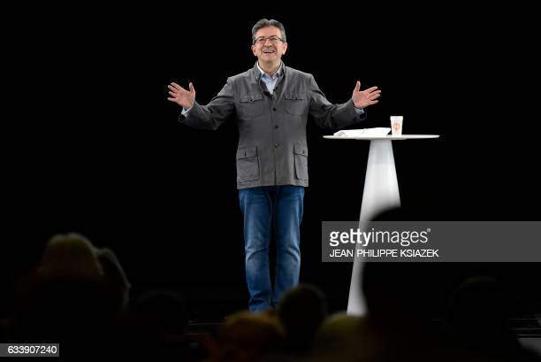"""French presidential election candidate for the far-left coalition """"La France insoumise"""" Jean-Luc Melenchon gestures as he delivers a speech during..."""