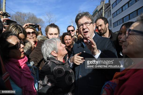 """French presidential election candidate for the far-left coalition """"La France insoumise"""" Jean-Luc Melenchon meets with women during a gathering as..."""