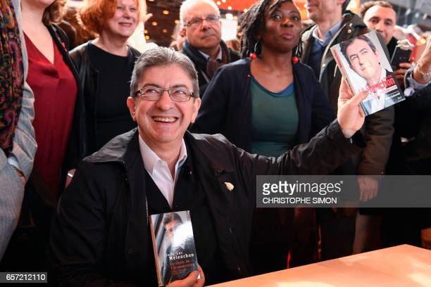 French presidential election candidate for the farleft coalition 'La France insoumise' JeanLuc Melenchon holds his book 'Le choix de l'insoumission'...