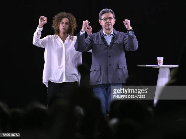 French presidential election candidate for the farleft coalition La France insoumise JeanLuc Melenchon delivers a speech with his spokesperson...