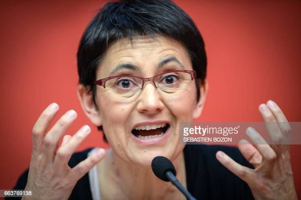 TOPSHOT French presidential election candidate for the farleft party Lutte Ouvriere Nathalie Arthaud gestures as she gives a speech during a campaign...