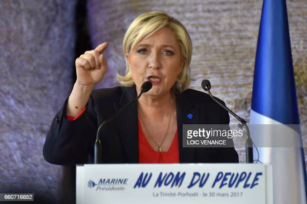 French presidential election candidate for the farright Front National party Marine Le Pen gestures as she delivers a speech during a campaign...