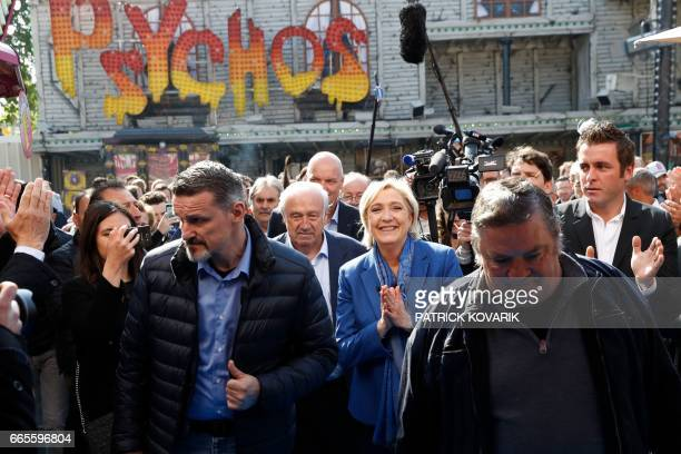 French presidential election candidate for the farright Front National party Marine Le Pen walks with Marcel Campion founder of the Foire du Trone...