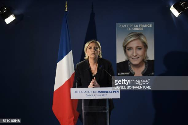 French presidential election candidate for the far-right Front National party Marine Le Pen speaks during a press conference on April 21, 2017 at her...
