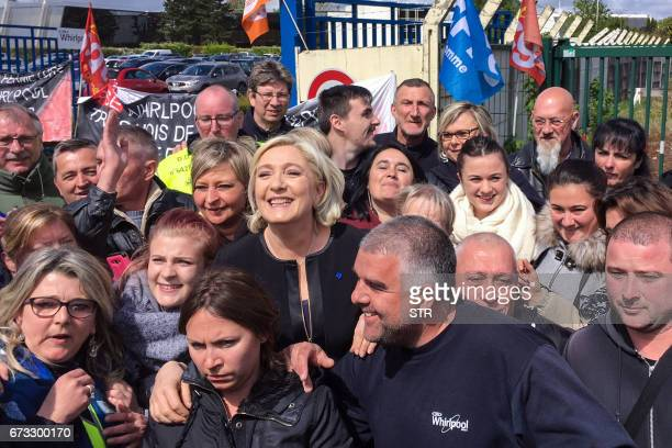 TOPSHOT French presidential election candidate for the farright Front National party Marine Le Pen smiles with people in front of the Whirlpool...