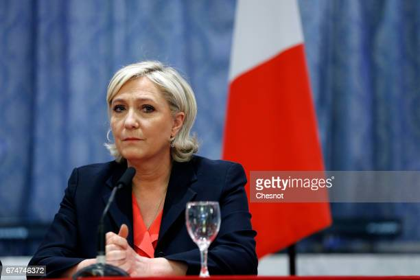 French presidential election candidate for the farright Front National party Marine Le Pen listens to French presidential election candidate for the...