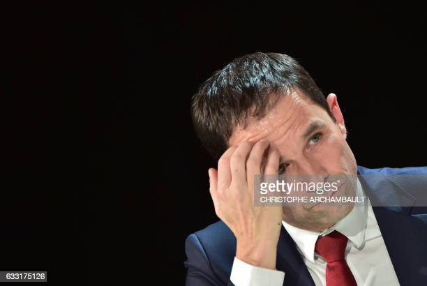 French presidential election candidate for the left-wing French Socialist party Benoit Hamon gestures as he delivers a speech during a debate...
