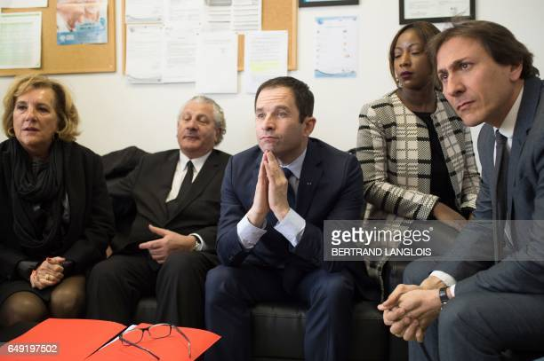 French presidential election candidate for the leftwing French Socialist party Benoit Hamon sits next to MP Henri Jibrayel and French Socialist Party...