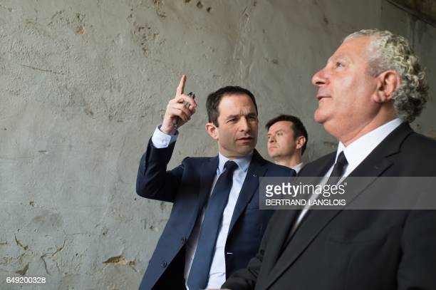 CORRECTION French presidential election candidate for the leftwing French Socialist party Benoit Hamon gestures next to MP Henri Jibrayel as he...