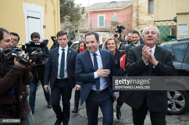 French presidential election candidate for the leftwing French Socialist party Benoit Hamon gestures next to MP Henri Jibrayel as he visits the...