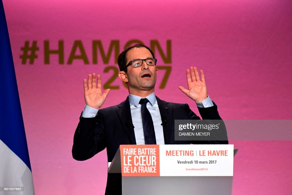 French presidential election candidate for the left-wing French Socialist (PS) party Benoit Hamon speaks during a campaign rally in Le Havre on March 10, 2017. / AFP PHOTO / Damien MEYER