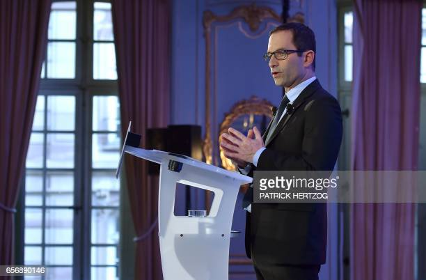French presidential election candidate for the left-wing French Socialist party Benoit Hamon gives a speech about defence policy, on March 23, 2017...