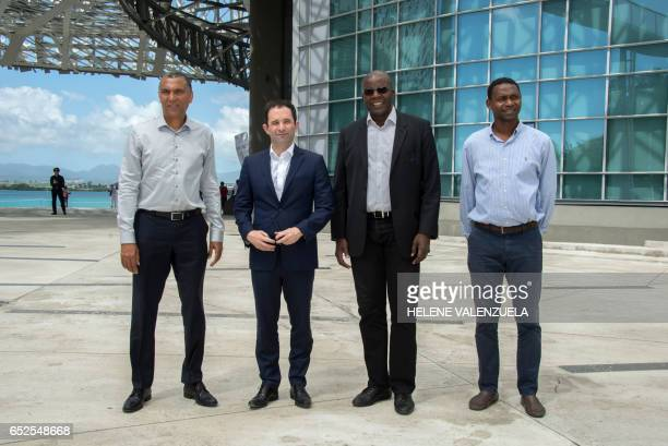 French presidential election candidate for the leftwing Socialist Party Benoit Hamon poses with PointeaPitre mayor Jacques Bangou president of the...