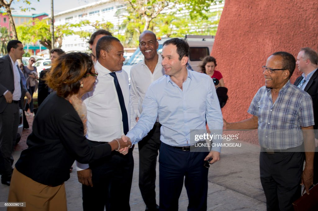 French presidential election candidate for the left-wing Socialist Party (PS) Benoit Hamon (2R) meets Mayor of Fort-France Didier Laguerre (2L) and former President of the Regional Council Serge Letchimy (C) during his visit to the French overseas territory of Martinique on March 13, 2017. / AFP PHOTO / Lionel CHAMOISEAU