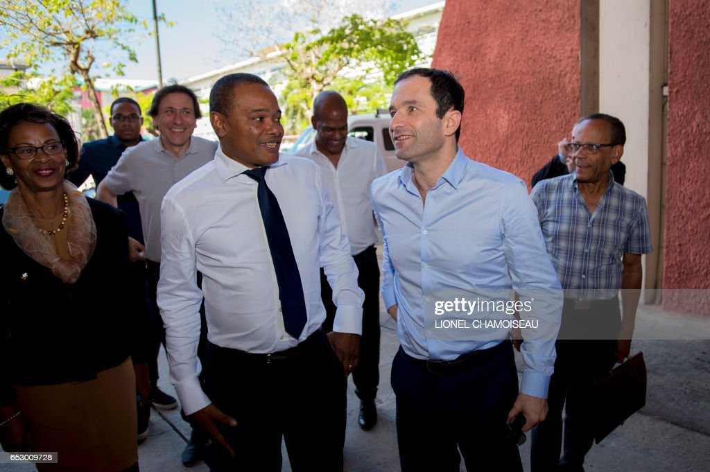 French presidential election candidate for the left-wing Socialist Party (PS) Benoit Hamon (2R) and French Socialist Party President of the General Council of Essonne Jerome Guedj (3L) meet Mayor o...