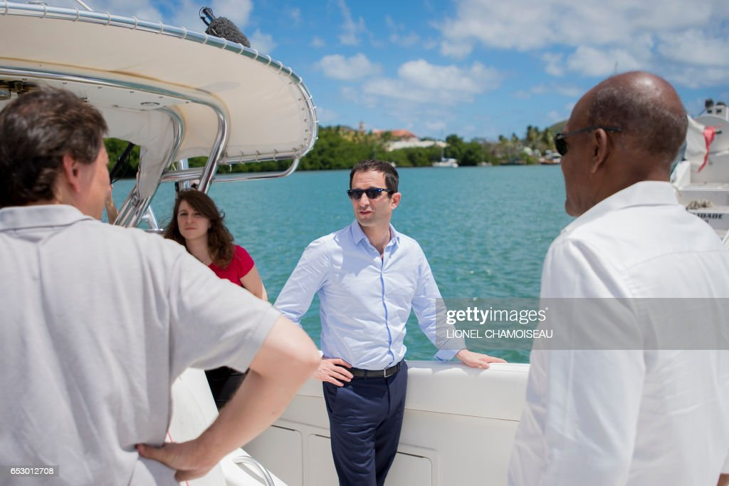 French presidential election candidate for the left-wing Socialist Party (PS) Benoit Hamon stands on a boat at a dry dock in Le Marin on March 13, 2017, during a trip to the French overseas territory of Martinique. / AFP PHOTO / Lionel CHAMOISEAU