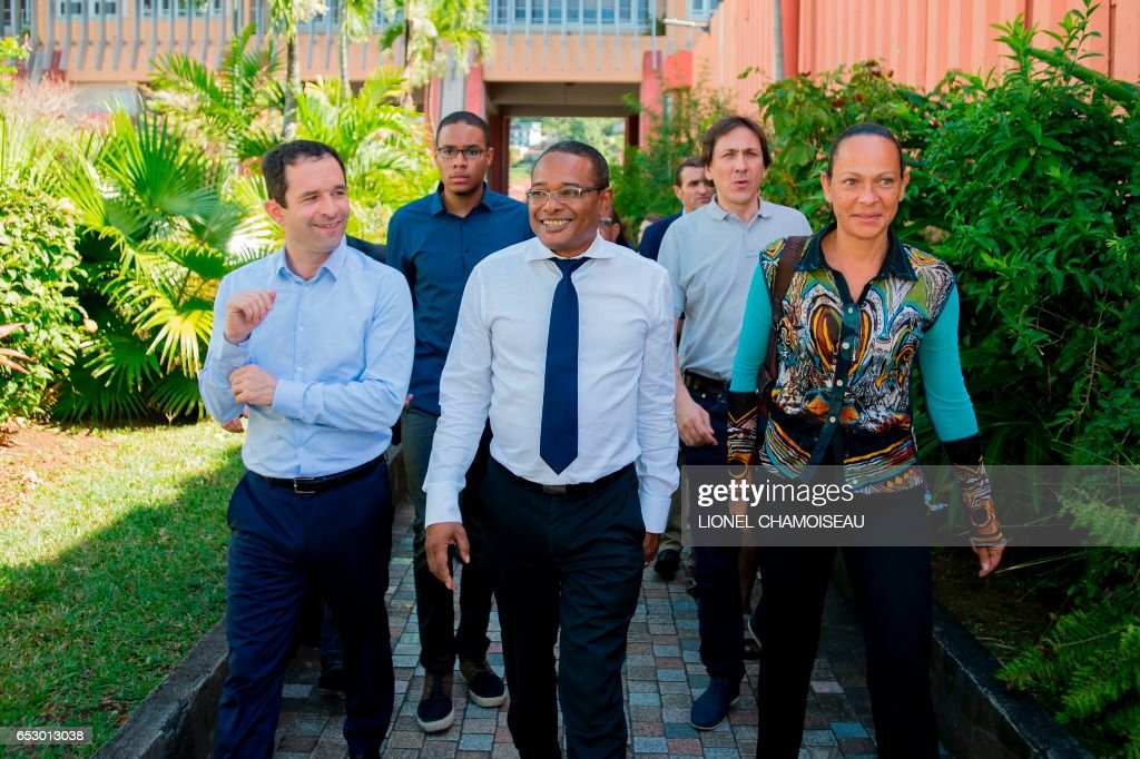 French presidential election candidate for the left-wing Socialist Party (PS) Benoit Hamon (L) and French Socialist Party President of the General Council of Essonne Jerome Guedj (2R) walk with May...
