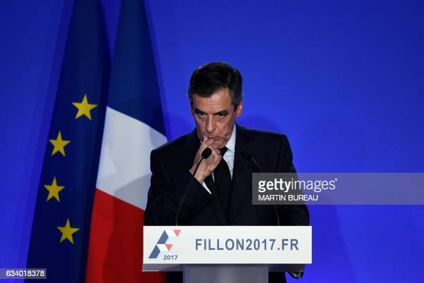 TOPSHOT French presidential election candidate for the rightwing Les Republicains party Francois Fillon gives a press conference focused on fake job...