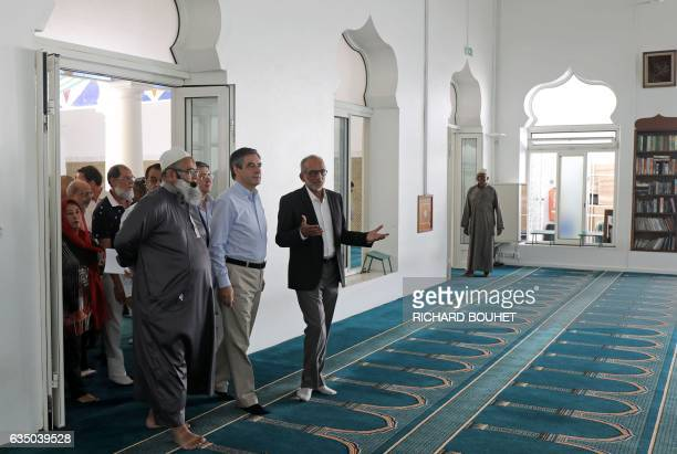 French presidential election candidate for the right-wing Les Republicains party, Francois Fillon listens to French imam Mohamad Bhagatte and the...
